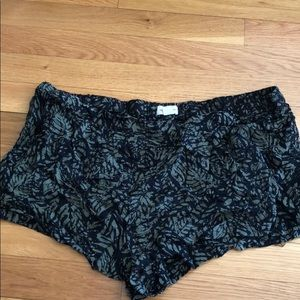green and black flowy shorts